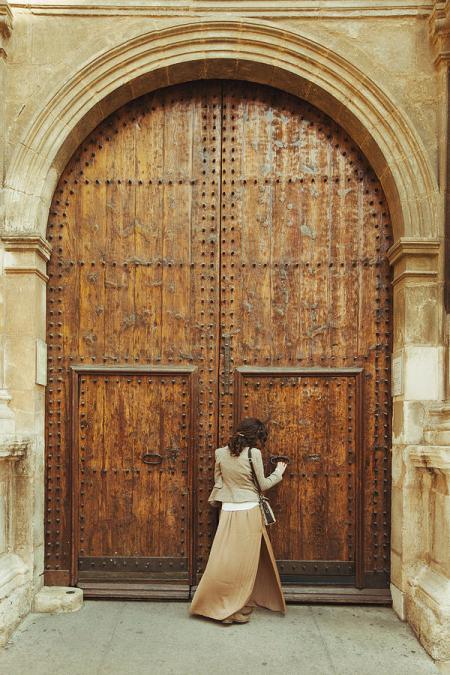 young-woman-standing-outside-church-door-rafael-elias
